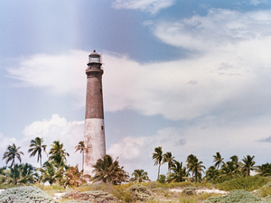 A lighthouse built in 1858 stands on Loggerhead Key, Fla., an uninhabited tropical island. Artists Paula Sprenger and Carter McCormick participated in a month-long artist residency here.