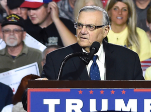 Sheriff Joe Arpaio, seen here at a rally for Republican presidential candidate Donald Trump earlier this month, is now facing criminal charges from federal prosecutors over his immigration patrols.