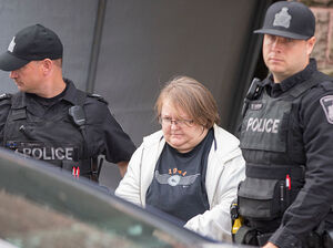 Elizabeth Tracey Mae Wettlaufer, a Canadian nurse accused of murdering eight elderly patients, leaves the courthouse Tuesday in Woodstock, Ontario.