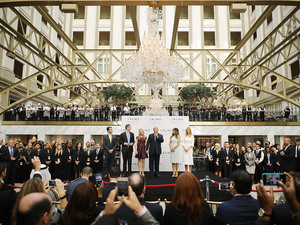 Donald Trump (center) and his family (from left), son Donald Trump Jr., son Eric Trump, wife Melania Trump and daughters Tiffany Trump and Ivanka Trump, prepare to cut the ribbon Wednesday at the Trump International Hotel Washington, D.C.
