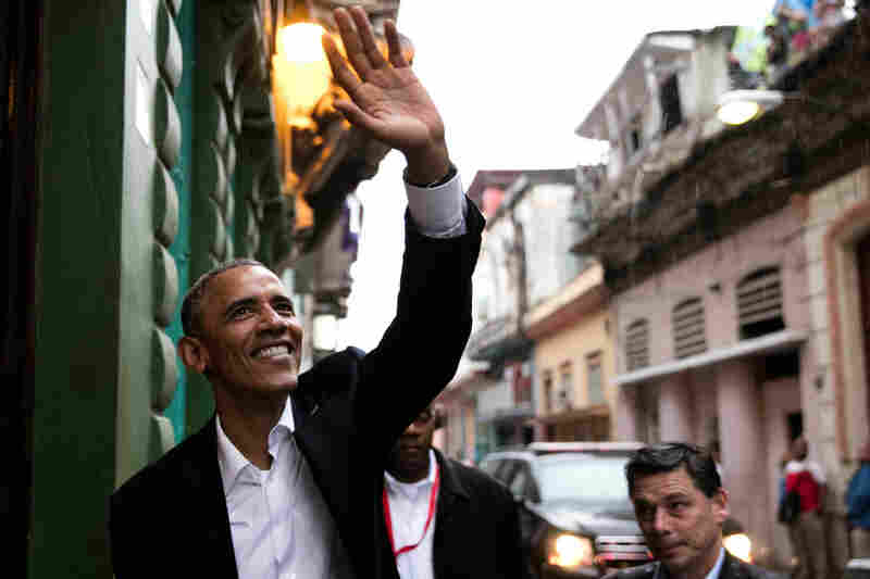President Obama waves to people as he enters a restaurant in Havana, Cuba on Mar. 20, 2016. His trip to Cuba is the first time an American president had visited the island since 1928.