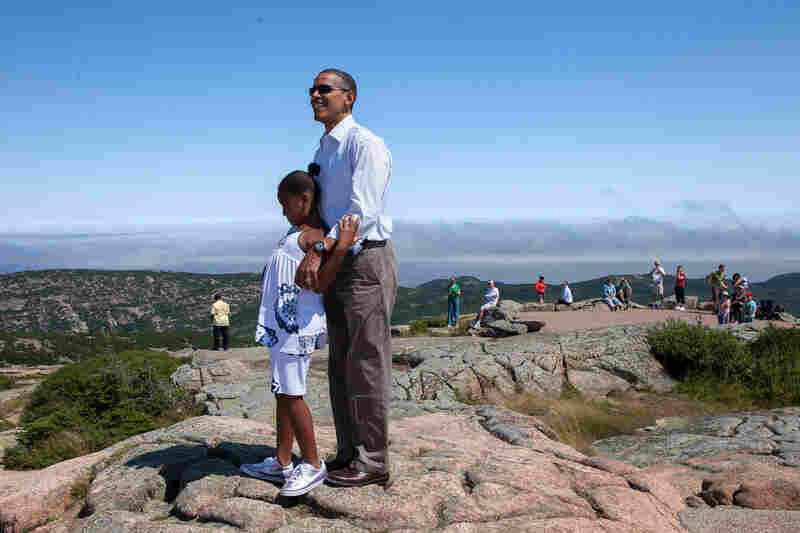 President Obama stands with his daughter, Sasha, on Cadillac Mountain in Acadia National Park, Maine in July 2010.