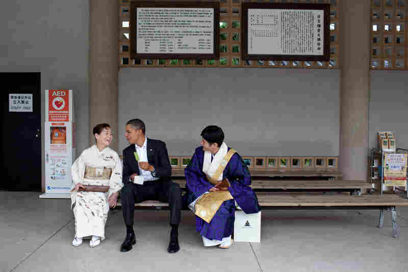 """Visiting the Great Buddha of Kamakura, in Japan, the President had a green tea ice cream bar with his hosts. He had visited this Buddha as a young child and said he remembered sitting in the exact same place having an ice cream bar,"" Pete Souza wrote on The White House Flickr page for this image from Obama's 2010 Japan visit."