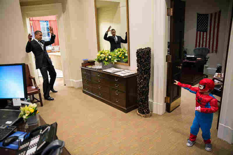 "President Obama reacts as Nicholas Tamarin, 3, greets him with Spider Man's web in October 2012. On The White House Flickr page, Souza said, ""I can never commit to calling any picture my favorite, but the President told me that this was his favorite picture of the year when he saw it hanging in the West Wing a couple of weeks later."""