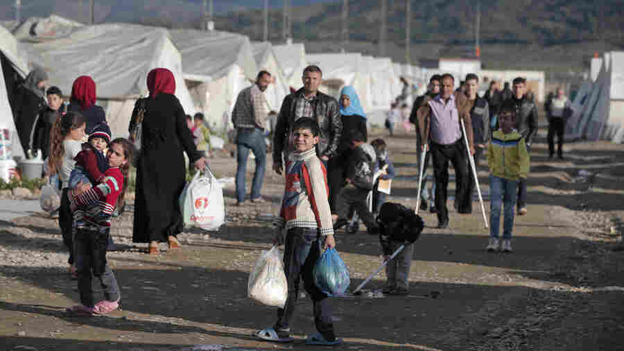 Europe's Aid Plan For Syrian Refugees: A Million Debit Cards