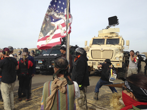 Dakota Access pipeline protesters defy law enforcement officers asking them to leave private land in the path of pipeline construction.