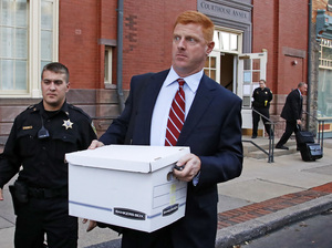 Former Penn State University assistant football coach Mike McQueary leaves the Centre County Courthouse Annex in Bellefonte, Pa., Monday, Oct. 17. He was awarded $7.3 million in damages for defamation.