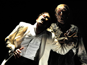 Don Giovanni (Gerald Finley, left) is pulled down to hell by the ghost of the Commendatore (Alastair Mills) in a Glyndebourne production of Mozart's Don Giovanni.