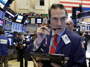 Trader Gregory Rowe works on the floor of the New York Stock Exchange on Oct. 17.