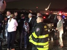 Republican presidential candidate Indiana Gov. Mike Pence (center) talks on the tarmac at New York City's LaGuardia Airport after his campaign plane slid off the runway while landing Thursday.