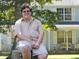 Gavin Grimm, a transgender teen, poses in front of his home in Gloucester, Va. The Supreme Court will take up transgender rights for the first time, deciding whether the school board may block Grimm from using the boys' bathroom at his high school.