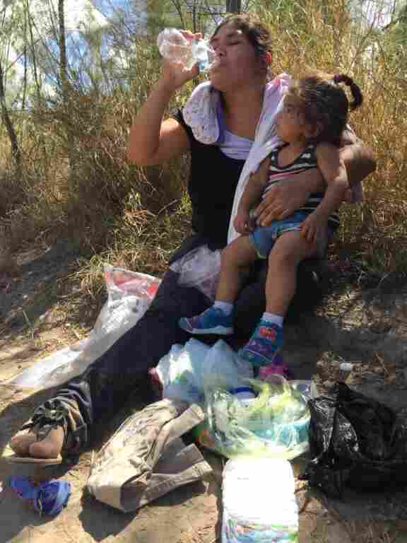 An immigrant from El Salvador and her 1-year-old daughter apprehended after crossing the Rio Grande near McAllen, Texas. She will ask for asylum.