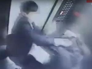 A scene from the elevator's security video, which shows the assailant repeatedly hitting the woman after she says she had asked him to stop smoking.