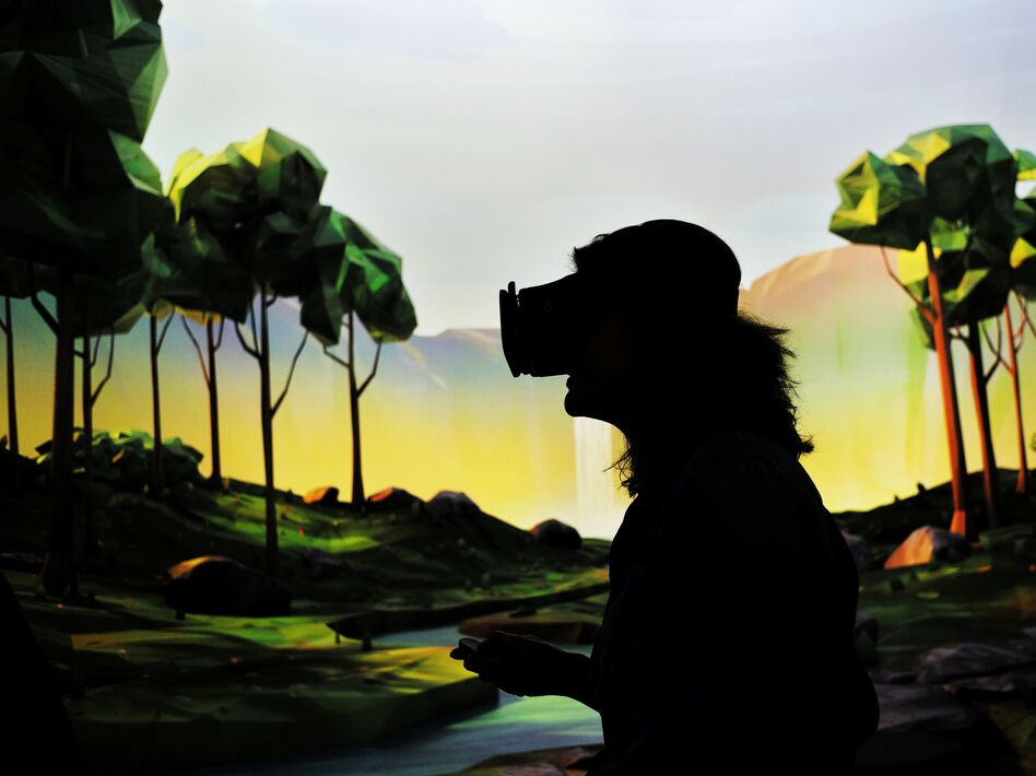 be1f7318ee27 A woman tries on Google s virtual reality device