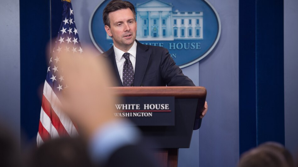 """White House spokesman Josh Earnest at the White House briefing Tuesday, where he said he would """"neither defend nor criticize what Director [James] Comey has decided to communicate to the public"""" regarding the investigation of Hillary Clinton's private email server. (Nicholas Kamm/AFP/Getty Images)"""