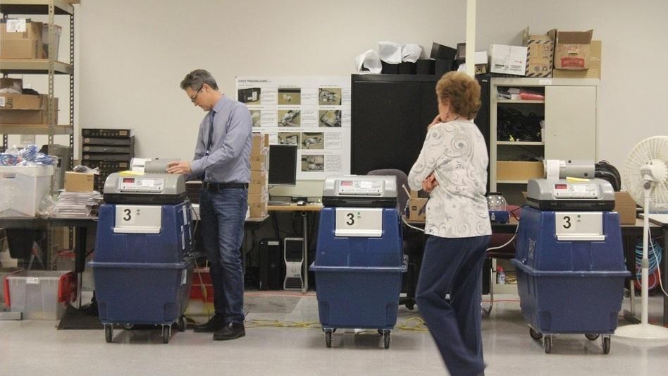 Election officials test ballot tabulation machines in Phoenix. (Carrie Jung/KJZZ)