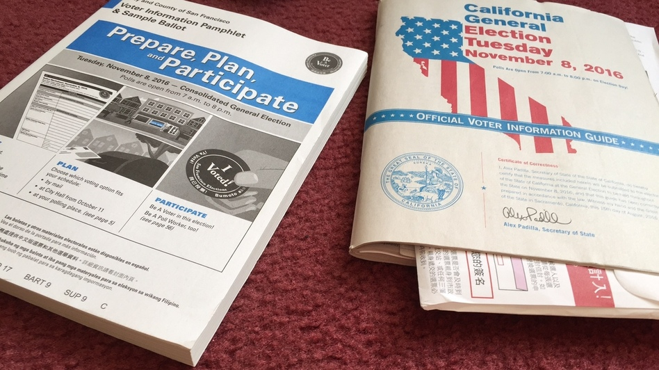 The City and County of San Francisco's voter information pamphlet explains its 25 local measures and the official state of California voter information guide explains its 17 state ballot measures. (Ben Adler/Capital Public Radio)