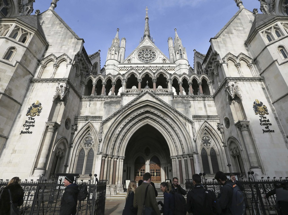 Media gather outside the High Court in London on Thursday for the decision on the challenge to plans for Brexit. (Tim Ireland/AP)