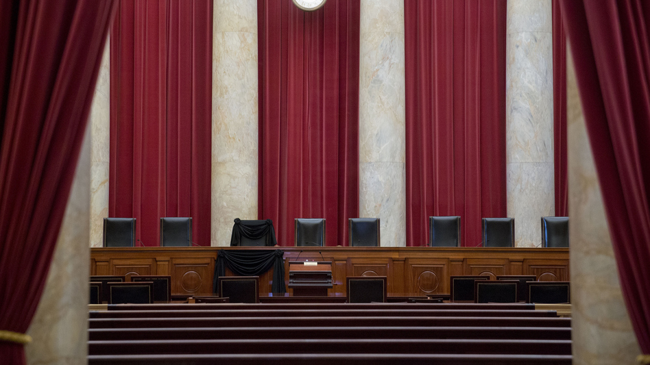 Eight out of nine chairs are seen at the Supreme Court, including one draped in black for Justice Antonin Scalia, who died in February. (Bloomberg via Getty Images)