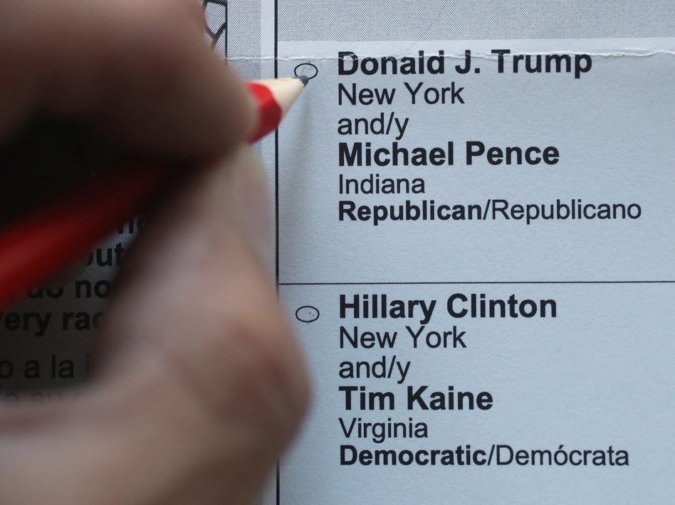 An American expat in Germany marks the Maryland ballot for the 2016 U.S. presidential election. (Sean Gallup/Getty Images)