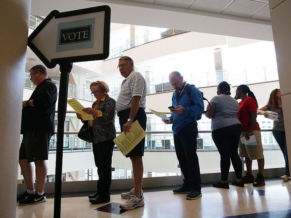 Voters in Winston-Salem, N.C., wait in line to cast their ballots during early voting for the 2016 general election. (Alex Wong/Getty Images)