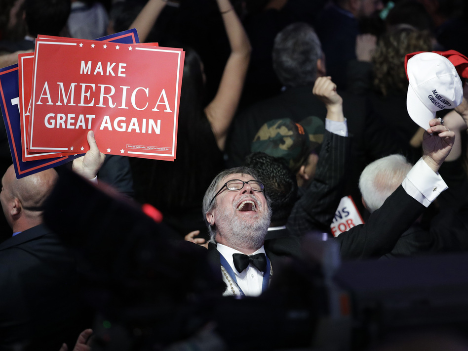 Supporters of Donald Trump react as they watch the election results during Trump's election night rally on Tuesday. (John Locher/AP)