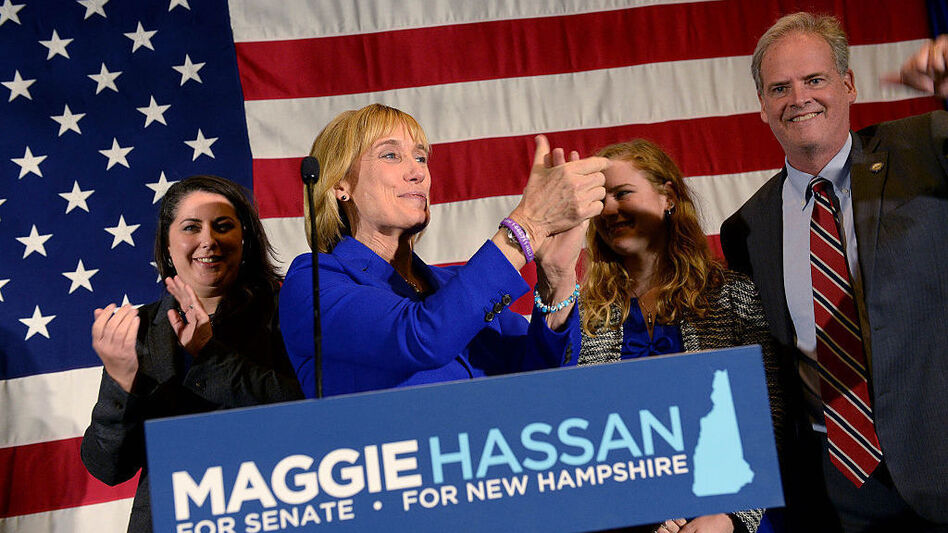 New Hampshire Gov. Maggie Hassan took the stage with her family to thank supporters on Tuesday night. (Darren McCollester/Getty Images)