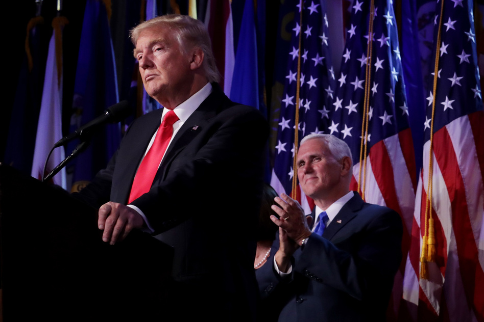 Republican president-elect Donald Trump delivers his acceptance speech as Vice president-elect Mike Pence looks on during his election night event at the New York Hilton Midtown in the early hours of Wednesday morning. (Chip Somodevilla/Getty Images)
