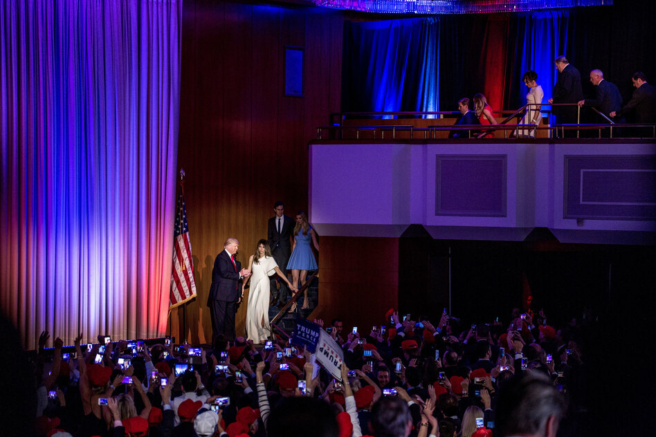 Donald Trump escorts his wife, Melania, to the stage moments before giving his acceptance speech. (Natalie Keyssar for NPR)