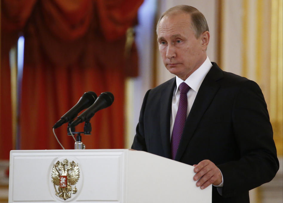 Russian President Vladimir Putin speaks at the Kremlin on Wednesday. Putin says that Moscow hopes to restore good relations with the United States in the wake of the election of Donald Trump. (Sergei Karpukhin/AP)