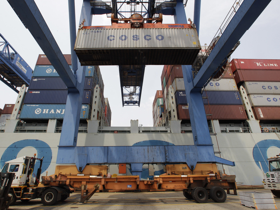 A container ship from China is offloaded at Massport's Conley Terminal in the port of Boston. (Stephan Savoia/AP)