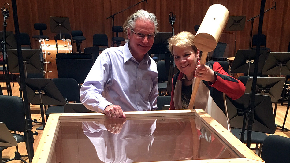 Baltimore Symphony Orchestra percussionist John Locke stands beside conductor Marin Alsop, who holds the giant hammer Gustav Mahler includes in his Sixth Symphony. (Baltimore Symphony Orchestra)
