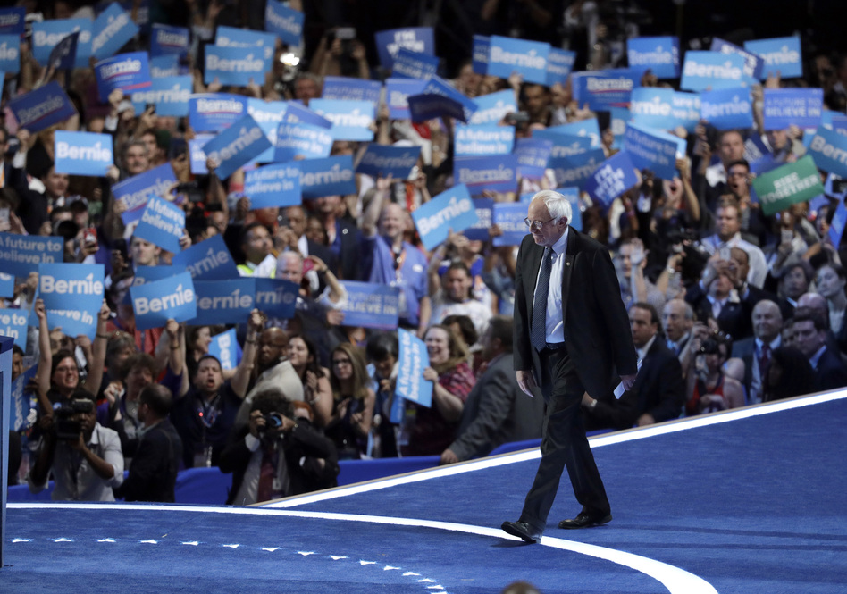 Former Democratic Presidential candidate, Sen. Bernie Sanders, I-Vt., takes the stage during the first day of the Democratic National Convention in Philadelphia , Monday, July 25, 2016. (John Locher/AP)