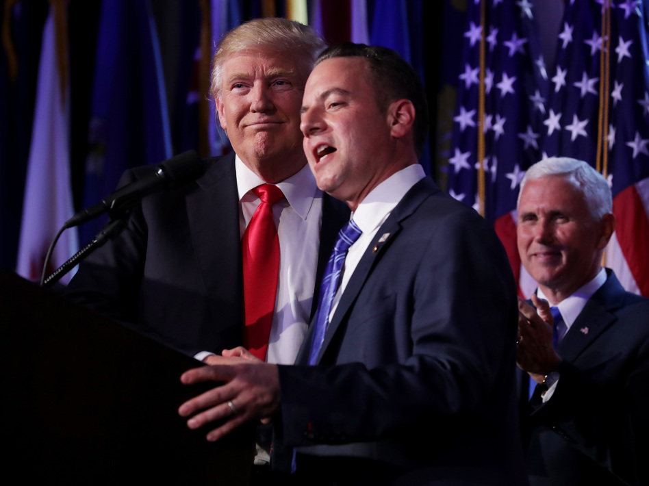 Reince Priebus, chairman of the Republican National Committee, delivers a speech as Republican President-elect Donald Trump looks on during his election night event in New York City. (Chip Somodevilla/Getty Images)