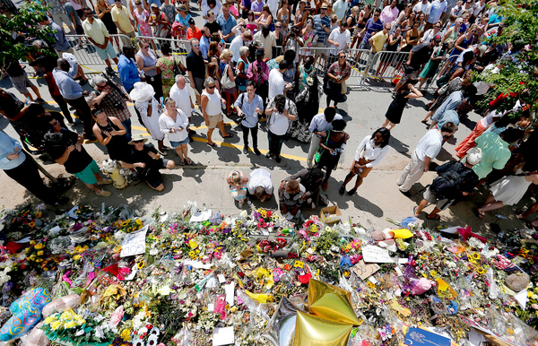 People pay respects outside of Emanuel African Methodist Church in June 2015 after a mass shooting that claimed the lives of nine people in Charleston, South Carolina.