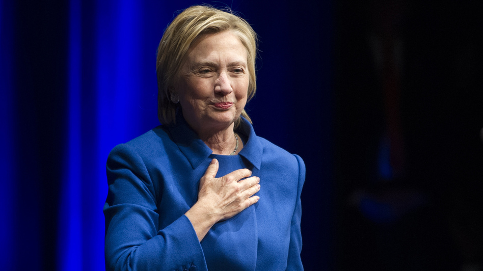 Hillary Clinton walks to the podium to address the Children's Defense Fund in Washington on Wednesday. (Cliff Owen/AP)