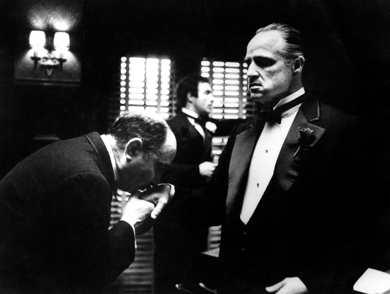 795b5739 Amerigo Bonasera (Salvatore Corsitto) kisses the hand of Don Vito Corleone (Marlon  Brando) in a scene from Francis Ford Coppola's The Godfather.