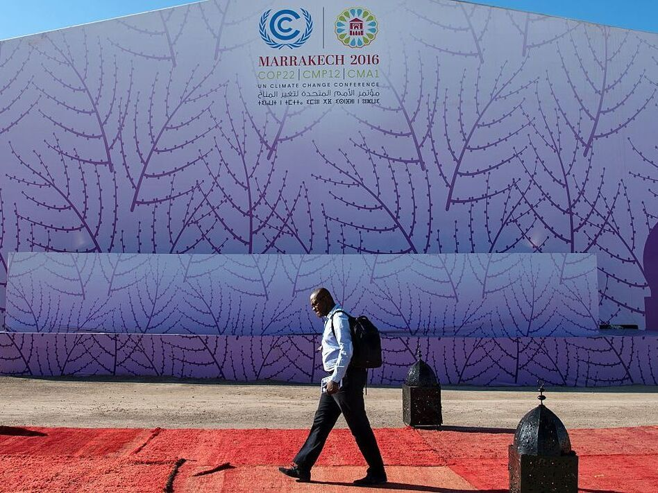 A man walks past the logo of the COP22 international climate conference on Nov. 9 in Marrakech, Morocco. (Fadel Senna /AFP/Getty Images)