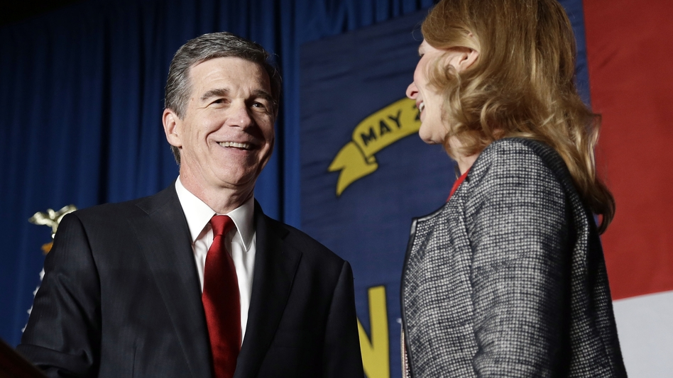 Democratic challenger Roy Cooper has a lead of more than 6,000 votes over Gov. Pat McCrory. He's seen here with his wife, Kristin, at an election night rally in Raleigh. (Gerry Broome/AP)