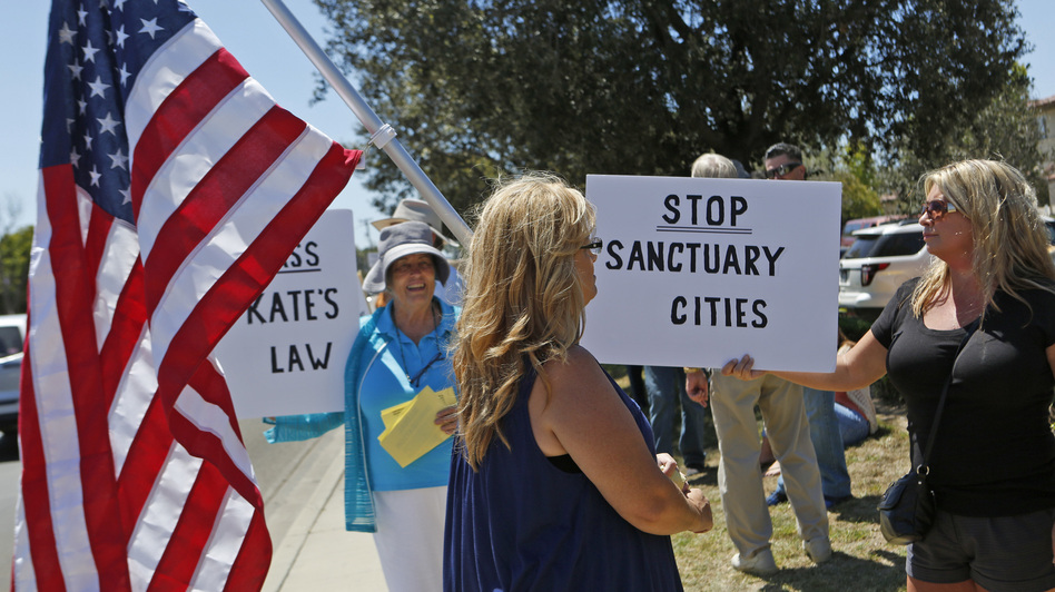 Carmen Spoerer, right, rallies among others protesting against sanctuary cities near the Santa Maria courthouse in Santa Maria, Calif. on Aug. 13. (Anne Cusack/Los Angeles Times via Getty Images)