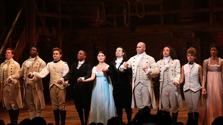 Leslie Odom Jr., Phillipa Soo and Ariana DeBose with Lin-Manuel Miranda with the cast during their final performance curtain call of <em>Hamilton</em> in July. (Walter McBride/WireImage/Getty Images)