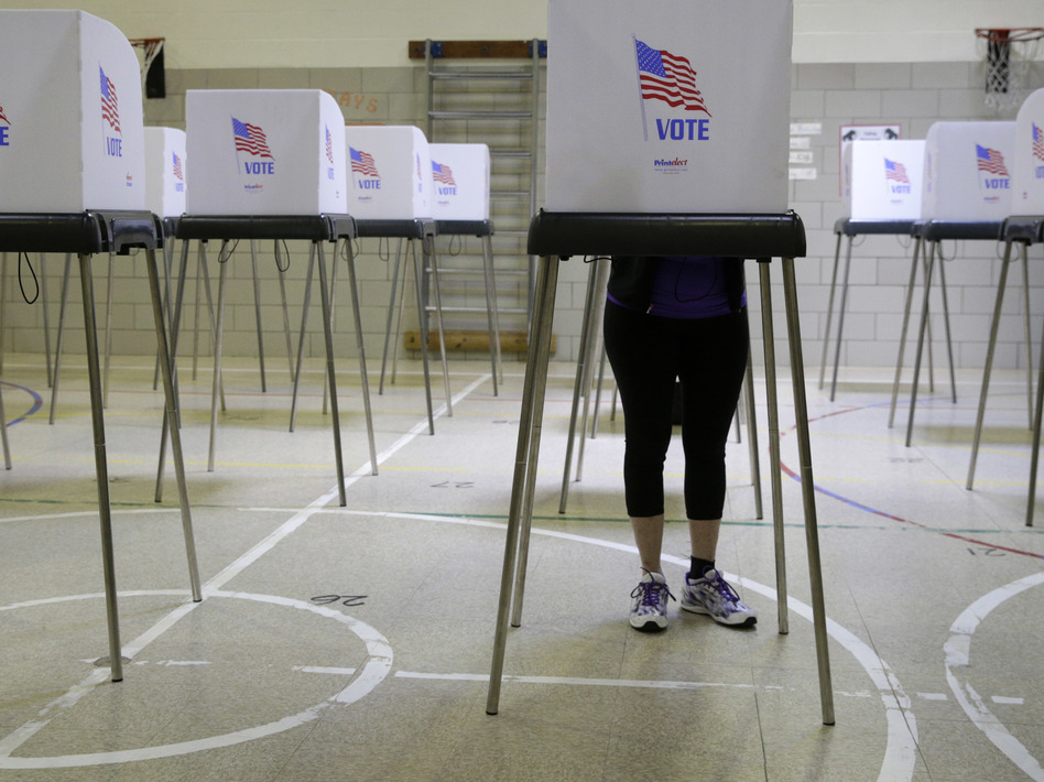 A woman casts her vote at a polling place inside Winfield Elementary School's gym in Windsor Mill, Md., during the state's 2016 primary. (Patrick Semansky/AP)
