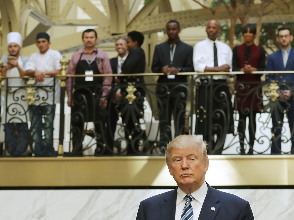 Hotel employees watch Donald Trump following a ribbon-cutting ceremony at the new Trump International Hotel on Oct. 26 in Washington, D.C. (Chip Somodevilla/Getty Images)