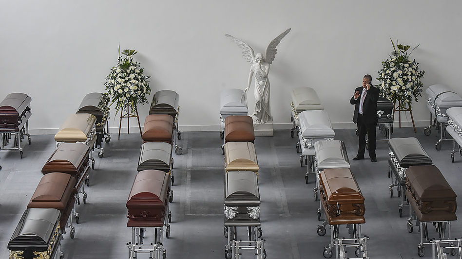 Some coffins for players of the Brazilian football team Chapecoense Real sit at a mortuary in Medellín, Colombia, on Wednesday. Investigators worked Thursday to finish identifying 71 victims of the plane crash as members of the public were left reeling by a harrowing recording of the pilot in the flight's final minutes.