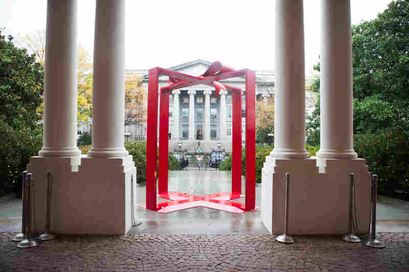"Following this year's White House holiday theme, ""The Gift of the Holidays,"" the first thing guests see when they arrive at the East Visitor Entrance is literally a giant present--the perfect spot for a holiday photo-op."