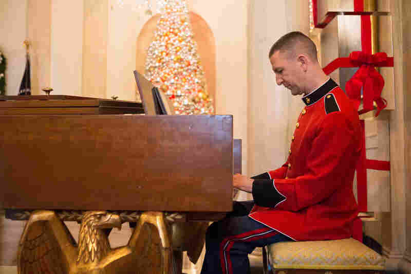 Gunnery Sargeant Russell Wilson from the United States Marine Band plays traditional Christmas songs in the Grand Foyer.