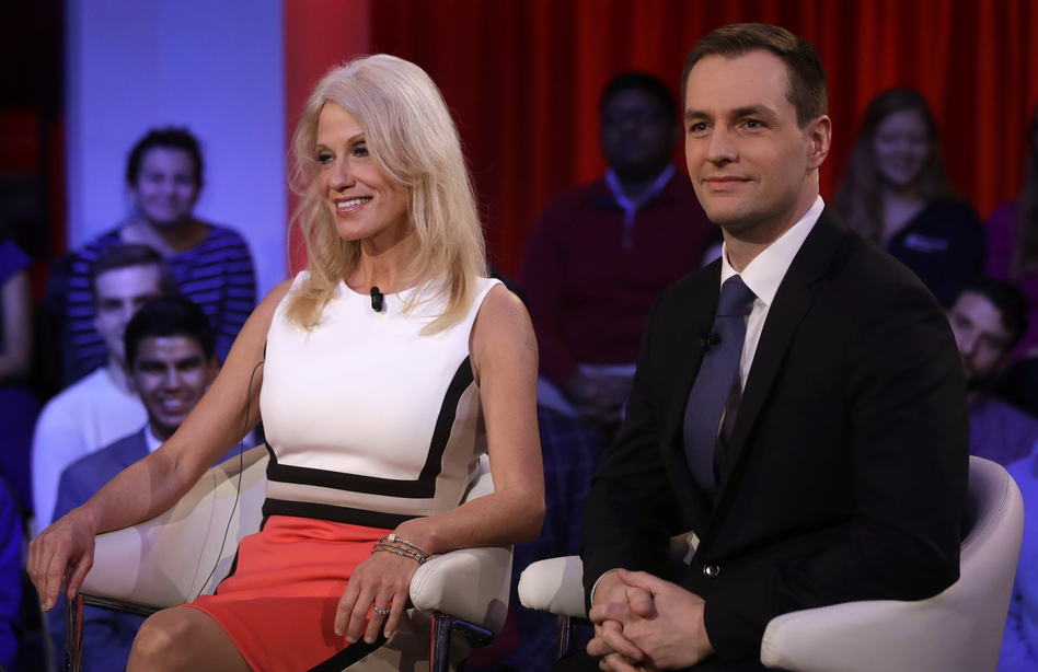 Trump campaign manager Kellyanne Conway sits with Robby Mook, Hillary Clinton's campaign manager, before a forum at Harvard University's Kennedy School of Government. (Charles Krupa/AP)