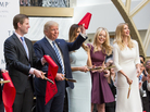 Standing with his son Eric, wife Melania, and daughters Tiffany and Ivanka, Donald J. Trump cuts the ribbon for his latest property, the Trump International Hotel in Washington, D.C., on Oct. 26.