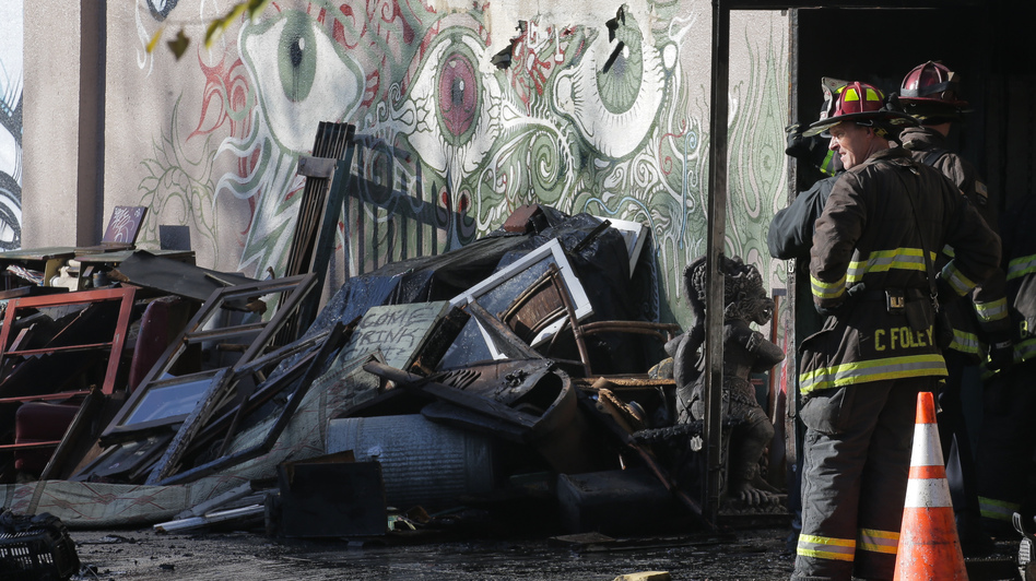 A collapsed roof and debris slowed down the recovery efforts of firefighters on Dec. 3 following a fire that killed at least 30 people at a warehouse in Oakland, Calif. (Elijah Nouvelage/Getty Images)