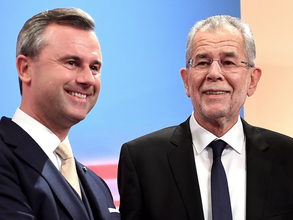 Austrian far-right candidate Norbert Hofer (L) and his rival Alexander Van der Bellen attend a post-selection TV talk with in Vienna on Dec. 4, 2016. Austrian far-right candidate Norbert Hofer on Sunday congratulated his opponent in presidential elections after projections indicated that he had lost. (Helmut Fohringer/AFP/Getty Images)